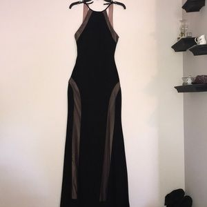 Black, maxi-dress with mesh over a dusty pink slip